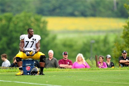 20140811_SteelersTrainingCamp010-2 Steelers OT Marcus Gilbert takes a break during workouts earlier this month at St. Vincent College in Latrobe, Pa.