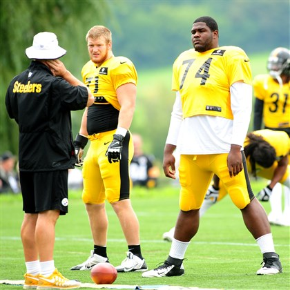 20140811_SteelersTrainingCamp001-1 Steelers Josh Mauro (71) and Daniel McCullers (74) during workouts Monday at St. Vincent College in Latrobe.