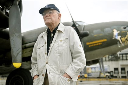"20140811rldB1704-3 Stanley Lantz, 89, of Butler, stands with the Boeing B-17 ""Memphis Belle"" at the Allegheny County Airport."
