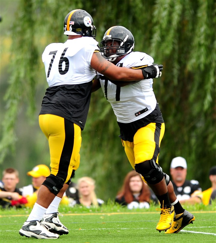 20140811_SteelersTrainingCamp009-7 Steelers tackles Mike Adams (left) and Marcus Gilbert during workouts earlier this month at St. Vincent College in Latrobe, Pa.