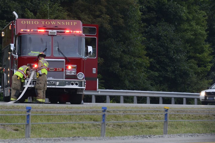 20140811dsParkwayNFatalLocal01.jpg Safety crews leave the scene of a fatal pedestrian accident this morning along the Parkway North.