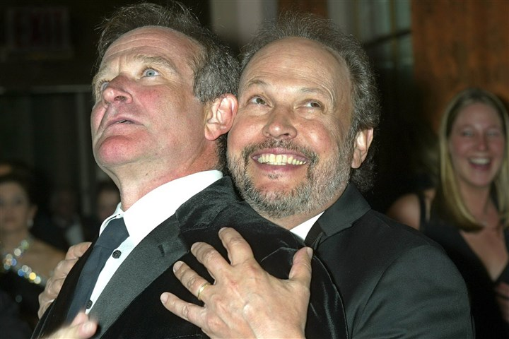 6J000KUN-2 Mr. Williams, left, shares a light moment with fellow actor Billy Crystal prior to the 18th annual American Museum of the Moving Image benefit in New York Wednesday, Feb. 12, 2003.