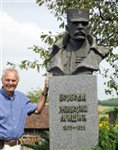 The author's husband, Slobodan Mitric, with a statue of one of Serbia's  most famous generals at the 1914 Battle of Cer in Serbia.