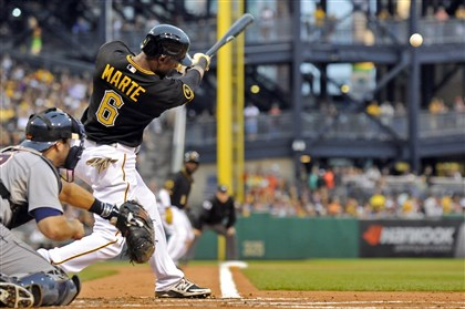 20140811mfbucssport03 Pirates' Starling Marte hits a three-run triple against the Padres in the first inning at PNC Park.