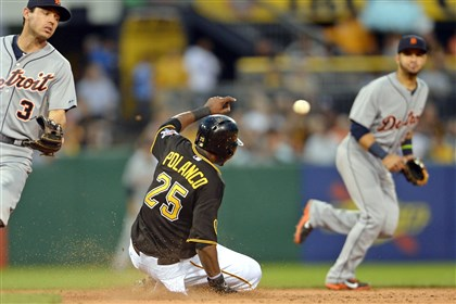 20140811mfbucssport07-4 Pirates' Gregory Polanco slides safely into second base on a steal attempt against the Padres at PNC Park. Polanco was safe at third base on a throwing error by Alex Avila.
