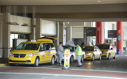 AirportCab2-1 Yellow Cabs line up outside the Pittsburgh International Airport in Findlay Township.