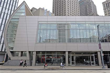 20140812CMAugustWilsonLocal004-1 Pedestrians walk past the August Wilson Center on Liberty Avenue, Downtown.