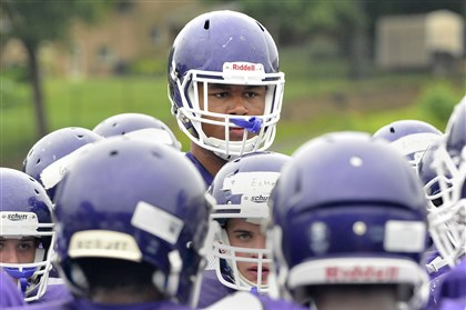 20140812lrbaldwinpracticesports14-12 At six feet eight inches and weighing 315 pounts, Baldwin High School offensive lineman Sterling Jenkins, center, is a head taller than most of his teammates.