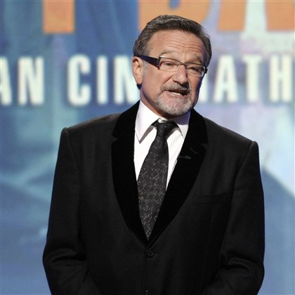 Obit Robin Williams This March 27, 2010 file photo shows actor Robin Williams speaking at The 24th American Cinematheque Awards honoring Matt Damon in Beverly Hills, Calif. Williams died in an apparent suicide. He was 63.
