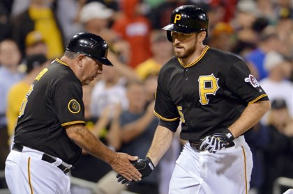 20140811mfbucssport10-3 Pirates' Ike Davis is congratulated by third base coach Nick Leyva after hitting a solo home run against the Padres in the sixth inning at PNC Park.