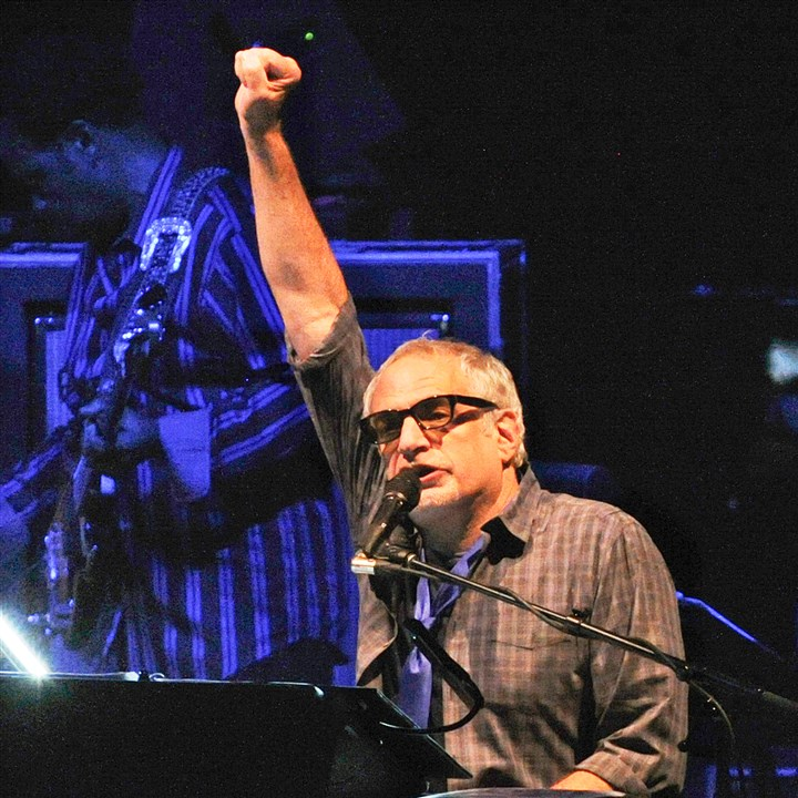 "20140911JHMAGSteelyDan02-1 Steely Dan's Donald Fagen acknowledges the audiences' reaction to ""Hey Nineteen"" at a sold-out Benedum Theater."
