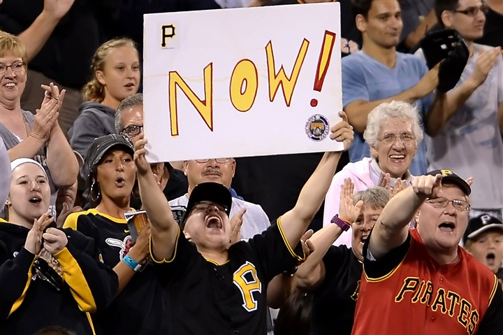 Pirates fans celebrate Pirates fans celebrate a solo home run by Ike Davis against the Tigers in the sixth inning at PNC Park Monday night, August 11, 2014.