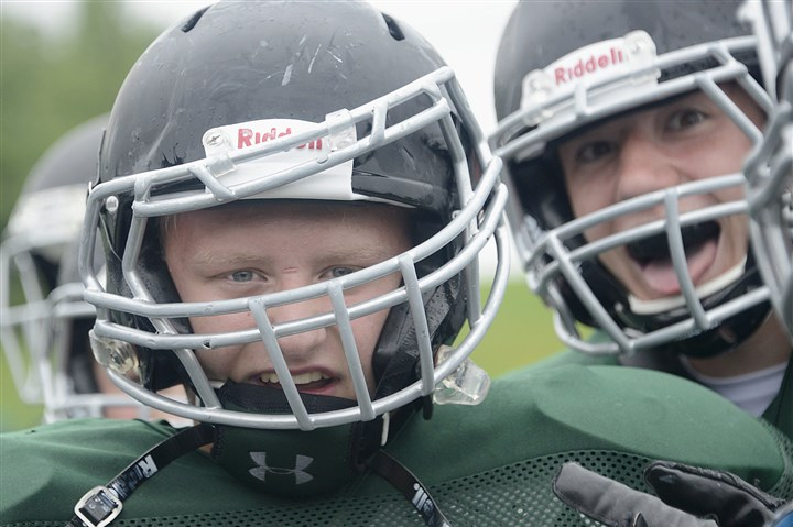 Nick Bird Pine-Richland's Nick Bird shows off his face mask, dislodged in a preseason practice tackling drill, as a badge of honor.