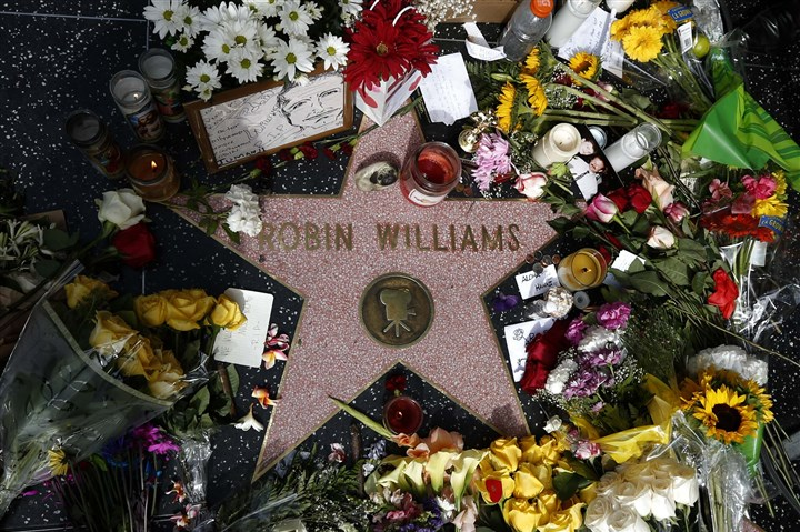 Robin Williams star 0812 Flowers are seen on the late Robin Williams' star on the Hollywood Walk of Fame in Los Angeles today..