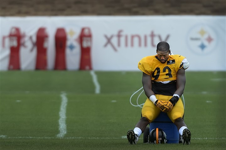 20140812pdSteelersSports08-4 Steelers linebacker Jason Worilds takes a break during workouts Tuesday at St. Vincent College in Latrobe, Pa.