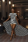 A model walks the runway wearing a Toya Taylor design in the