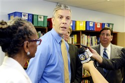 U. S. Secretary of Education Arne Duncan speaks during his visit to Pittsburgh Aug. 13. Also pictured are, from left, Pittsburgh Public Schools Superintendent Linda Lane, Allegheny County Executive Rich Fitzgerald  and Mayor Bill Peduto.