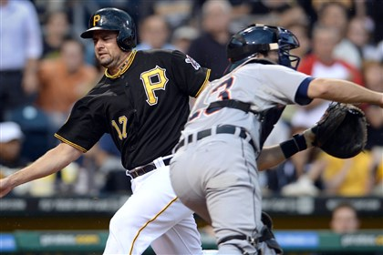 20140812mfbucssports02 Pirates' Gaby Sanchez scores on Tigers' Alex Avila in the second inning at PNC Park.