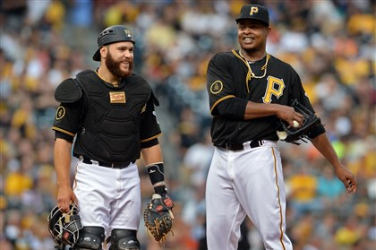 20140812mfbucssports04-2 Pirates catcher Russell Martin talks with starting pitcher Edinson Volquez as they take on the Tigers on Tuesday at PNC Park.
