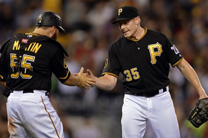 20140812mfbucssports08-1 Pirates' Russell Martin congratulates closer Mark Melancon after getting the final out against the Tigers at PNC Park.