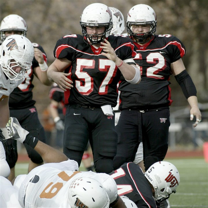wanneraction.jpg North Hills graduate John Wanner (57) is at the center of the action for Washington & Jefferson College.