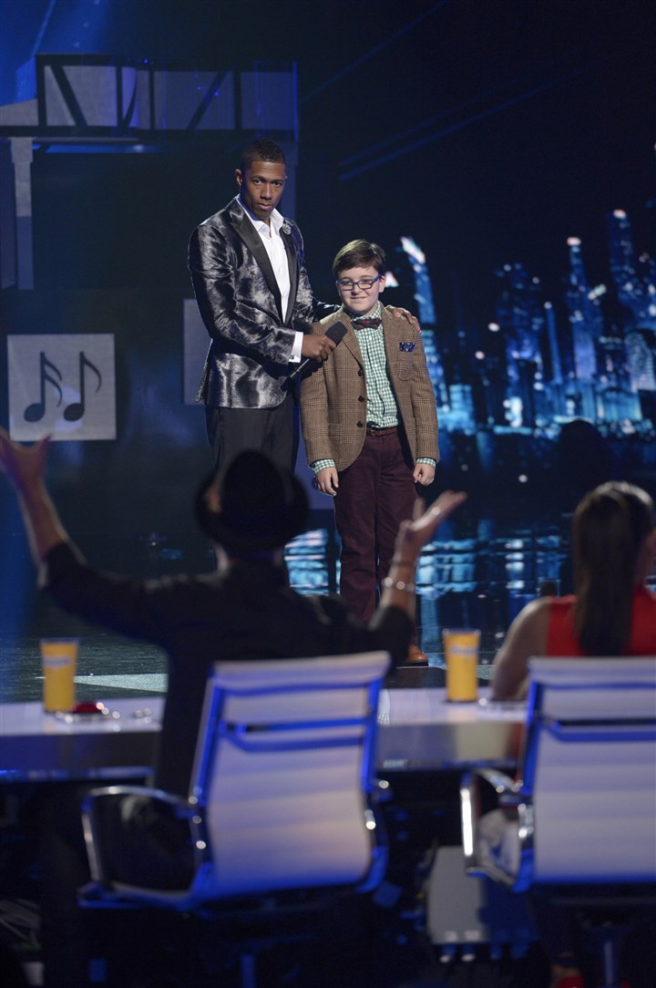 "former Pittsburgh piano prodigy Adrian Romoff ""America's Got Talent"" host Nick Cannon chats with former Pittsburgh piano prodigy Adrian Romoff."
