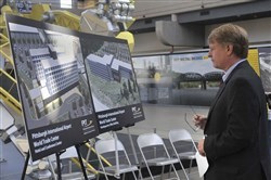 Allegheny County Executive Rich Fitzgerald surveys the artwork showing plans for the new Pittsburgh International Airport World Trade Center before a Thursday news conference.