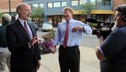 20140814JHLocalCandidates05 Tom Wolf, nominee for governor and Rich Fitzgerald joke with the media , outside the Pittsburgh Improv at the Waterfront in Homestead.