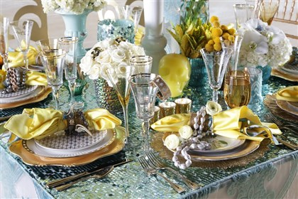 20140814hdBridalMag (2)-3 Table settings that mix and match multiple items of all sorts of sizes and textures add visual interest and personality to a reception, says florist and event stylist Bill Chisnell.