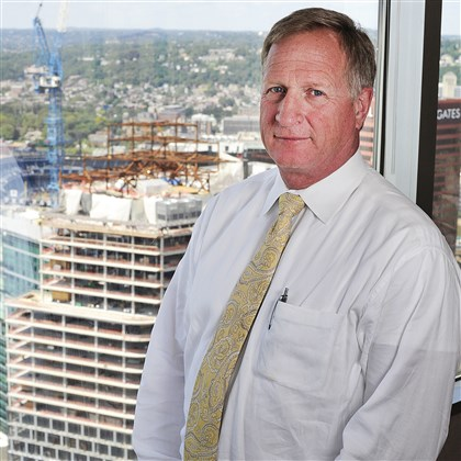 Steve Guy Oxford CEO Steve Guy, CEO of Oxford Development Co., can view the progress of the new PNC Tower from his office. Mr. Guy's company plans to build a 20-story office tower on Smithfield Street, Downtown.
