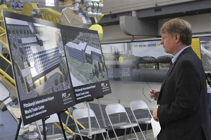 20140814lrcorbetttradelocal20-4 Allegheny County Executive Rich Fitzgerald surveys the artwork showing plans for the new Pittsburgh International Airport World Trade Center before a Thursday news conference.