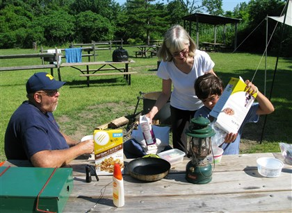 A campsite at Floyd Bennett Field Steve Kass, left, his wife Beth and son Kyle of Carol Stream, Ill., eat breakfast at Floyd Bennett Field, a campground in south Brooklyn, N.Y.