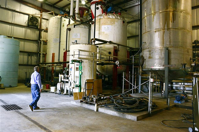Ed Vescovi walks through an idled biodiesel plant now owned by Weavertown Environmental Group in Beaver County. The plant is on hold, pending an uptick in market conditions and a signal from the federal government on biodiesel blending mandates.