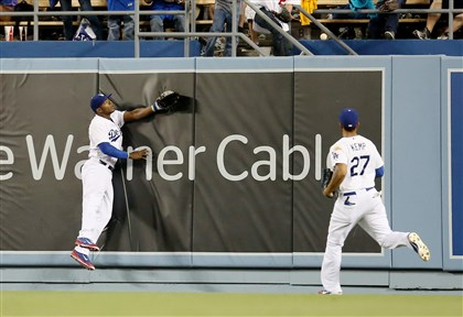 sportscable3 Center fielder Yasiel Puig, left, and right fielder Matt Kemp of the Los Angeles Dodgers at Dodger Stadium last month. Time Warner Cable's SportsNet LA network features the Dodgers.
