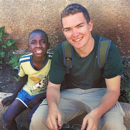 Missionary4 Pine Richand senior Connor Grieb with orphan boy at Grace Mission Orphanage in Limbe.