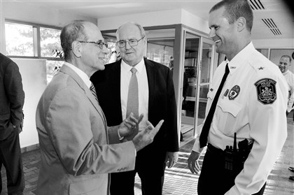 20140813bwChiefWest01 Collier Township manager Salvatore Sirabella, left, speaks with new police Chief Craig Campbell as Judge Gerard Bigley looks on following a swearing-in reception for the chief.