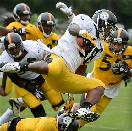 20140814pdSteelersSports09-7 Running back Tauren Poole was among 15 players cut from the Steelers roster today.