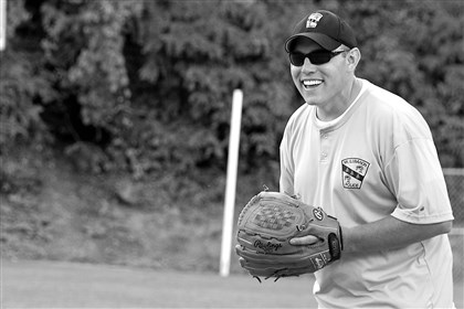 20140815hdPoliceSouth (1) Aaron Lauth gets ready to pitch for the Mt. Lebanon team during the Aug. 13 Badges 'n' Bat game in Mt. Lebanon.