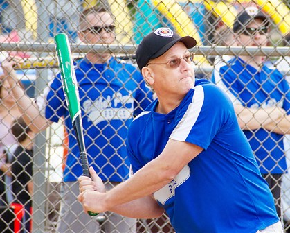 20140815hdPoliceSouth (4)-3 Tom Rigatti bats for the Bethel Park team during the Badges 'n' Bats event Aug. 13 to benefit Special Olympics.
