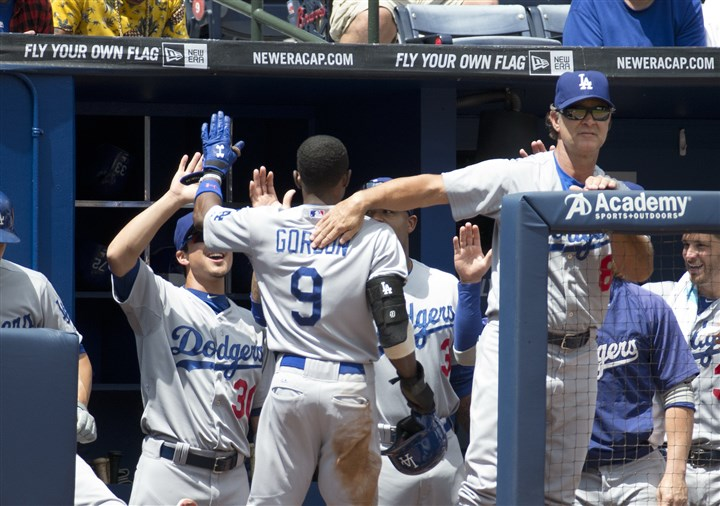 sportscable Los Angeles Dodgers' dugout celebrates a base hit. The Los Angeles Times reports that the new all-Dodgers network is not available on 70 percent of televisions in the Los Angeles market — the second-largest TV market in the nation.