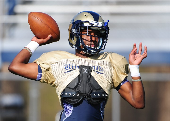 20140815lfFootballSports04-3 Ringgold quarterback Nico Law at practice Aug. 15.