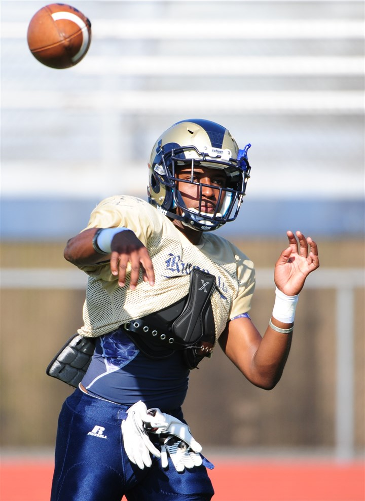 20140815lfFootballSports03-2 Ringgold quarterback Nico Law at practice Aug. 15.