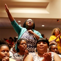 9s000no0 People attend an event for slain 18-year-old Michael Brown at the Greater Grace Church on Sunday in Ferguson, Missouri. The event was led by the Rev. Al Sharpton in support of justice for Michael Brown, who was killed by police on Aug. 9.