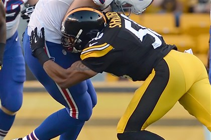 20140816mfsteelerssports11-2 Steelers rookie Ryan Shazier takes down the Bills' Scott Chandler in the first quarter at Heinz Field.