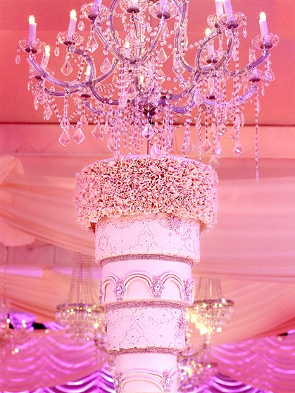 Suspended wedding cake at Candace and Tino Rionda III's wedding. Cake was made by Bella Christie and Lil' Z's Sweet Boutique.