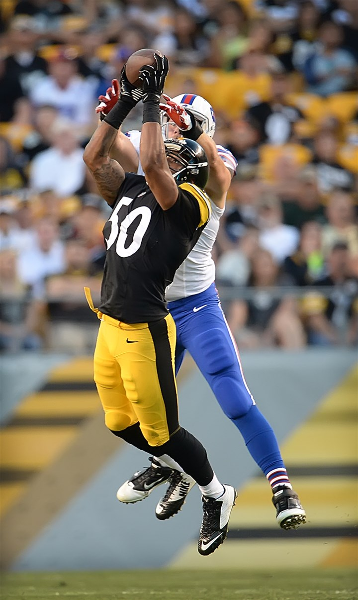 shazier-interception-steelers-preseason-bills Pittsburgh Steelers rookie linebacker Ryan Shazier intercepts pass in front of Buffalo Bills tight end Scott Chandler in the first quarter Saturday at Heinz Field.