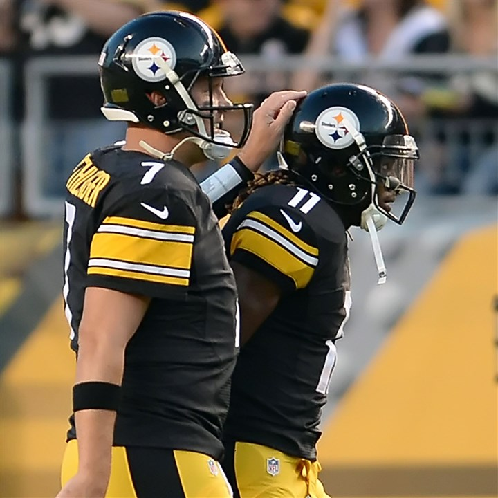 20140816mfsteelerssports07-3 Steelers quarterback Ben Roethlisberger congratulates Markus Wheaton on his touchdown against the Bills in the first quarter at Heinz Field on Saturday night.