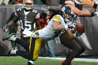 polamalu3 Troy Polamalu nearly intercepts a pass against Browns tight end Jordan Cameron last season at FirstEnergy Stadium in Cleveland.