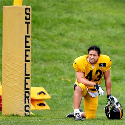 polamalu2-1 Steelers safety Troy Polamalu takes a break during an afternoon practice earlier this month at Saint Vincent College in Latrobe.