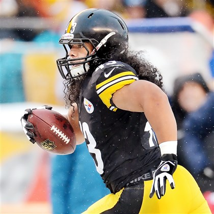 polamalu Troy Polamalu heads for the end zone after interception against the Dolphins at Heinz Field in December.